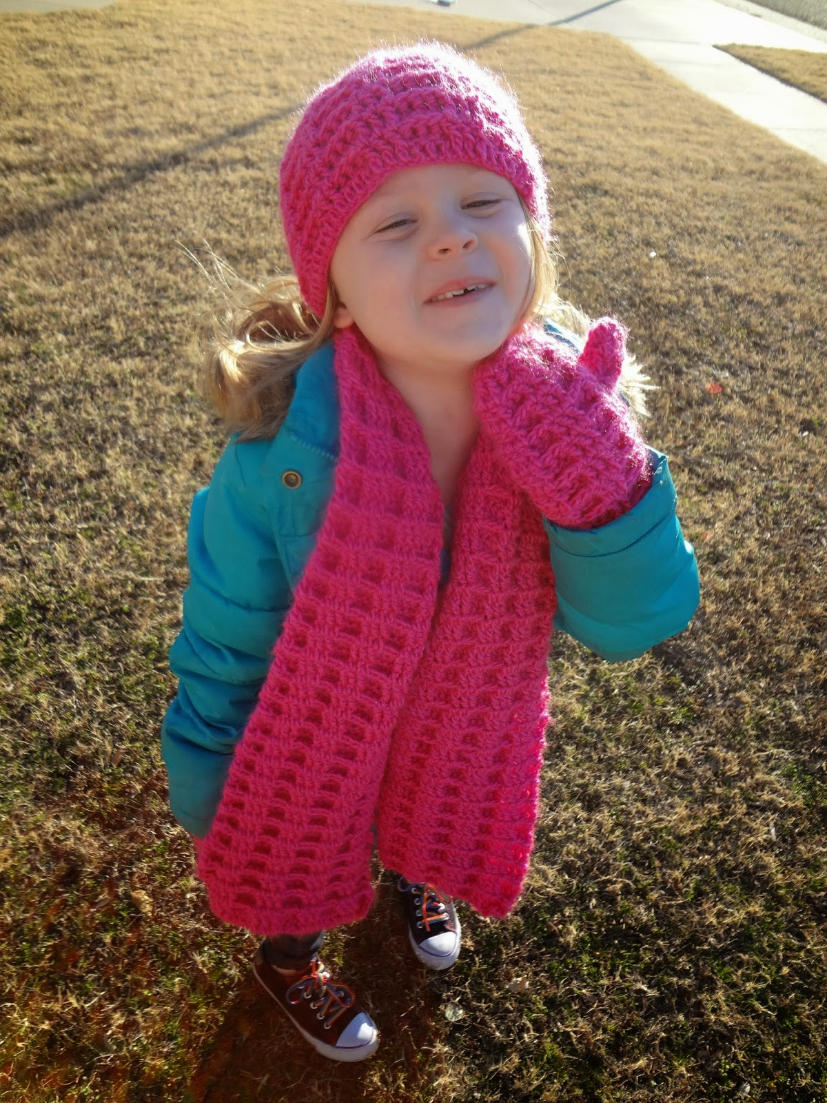Hot pink crochet hat, scarf, and mitten set. Free pattern from Banana Moon Studio!