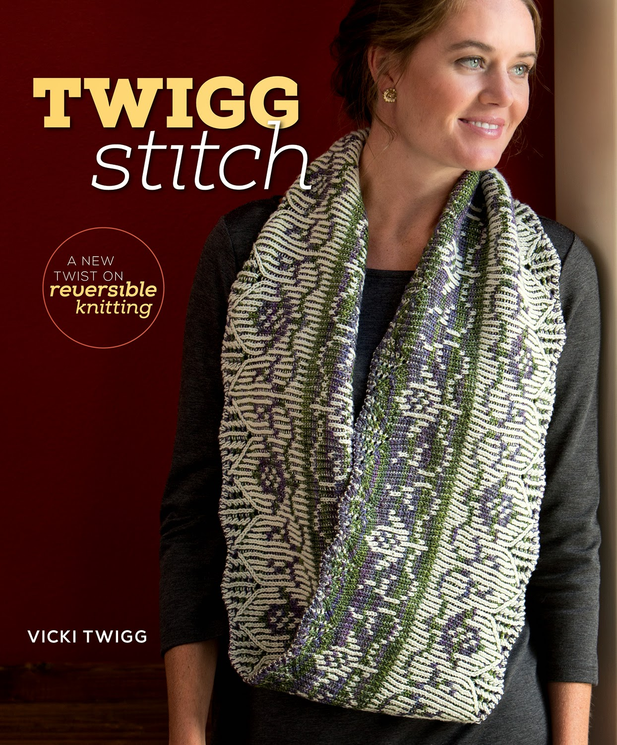 Cover of the Twigg Stitch book with a woman wearing a white, purple, and green knit colorwork double-sided knit scarf pattern. Text reads: Twigg Stitch. A new twist on reversible knitting. Vicki Twigg.