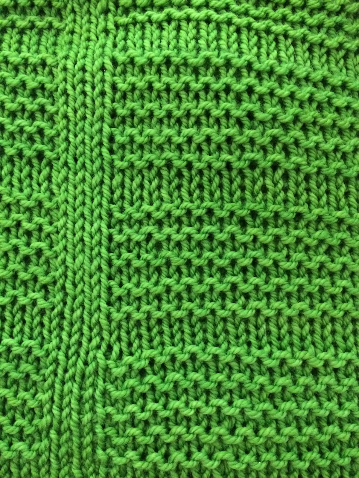 Close up view of a sour apple green knit cowl with texture designed by Banana Moon Studio. Free with subscription!