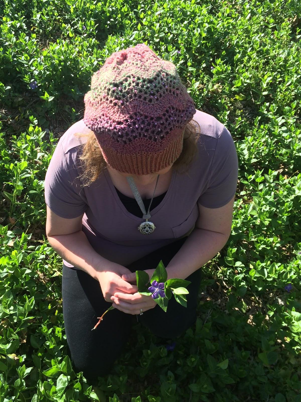 Woman wearing a crochet beaded hat.