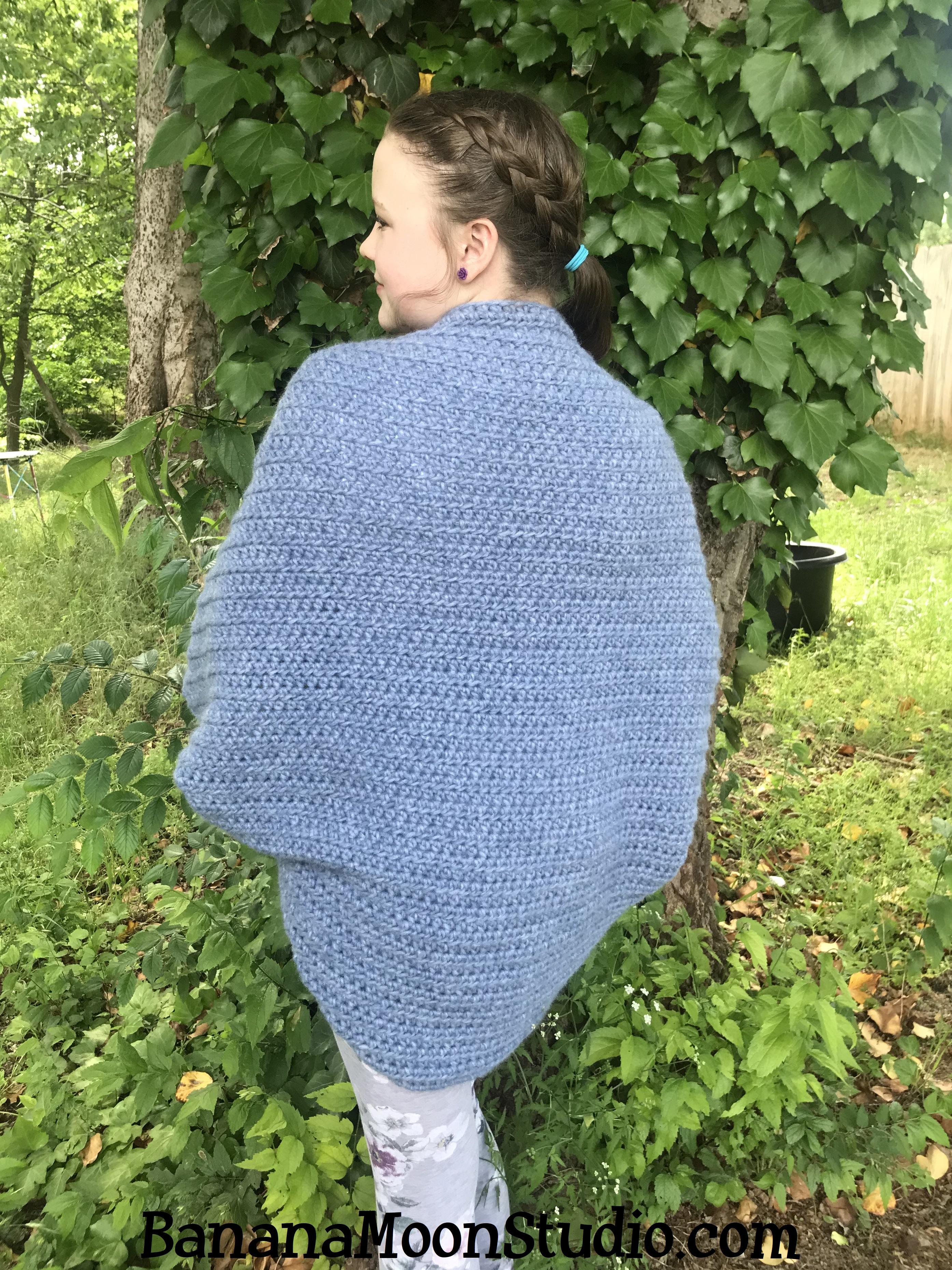 Free, easy crochet pattern for this women's blanket shrug, from Banana Moon Studio