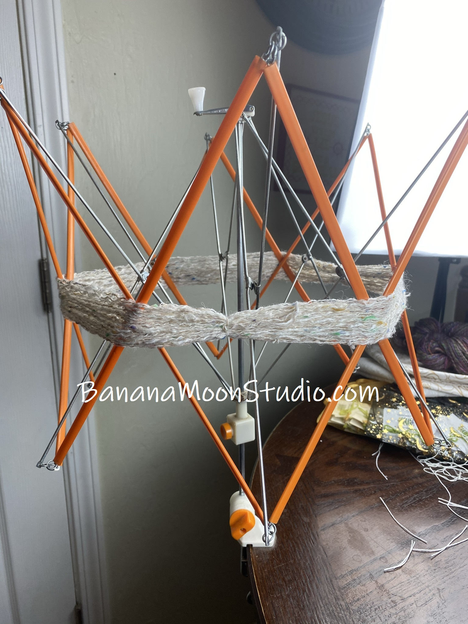 Use a yarn swift or other object to wrap your yarn around, how to block acrylic yarn, photo tutorial from Banana Moon Studio
