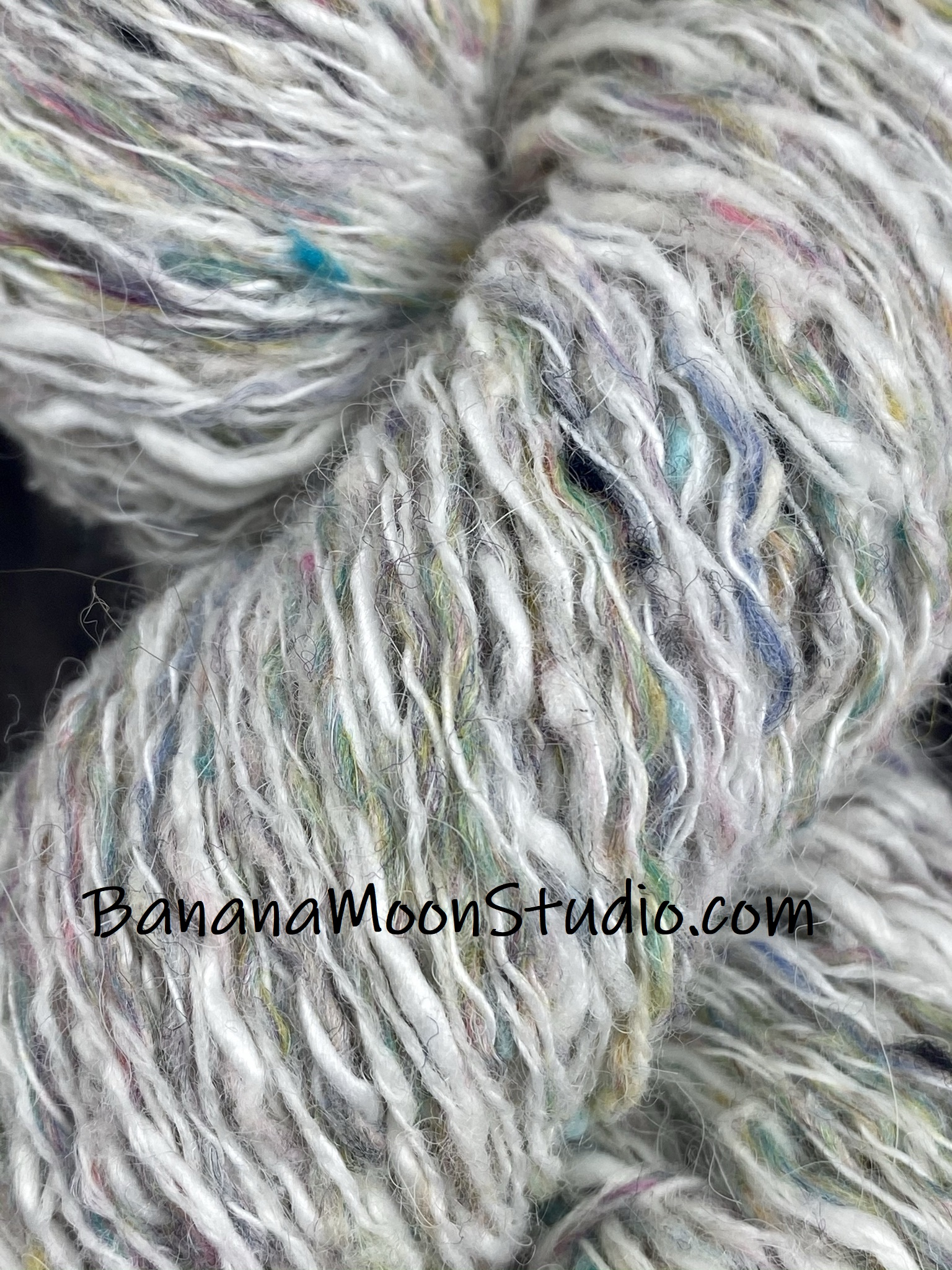 As you can see, wet blocking doesn't work for synthetic fibers. They need steam blocking. Photo tutorial from Banana Moon Studio.