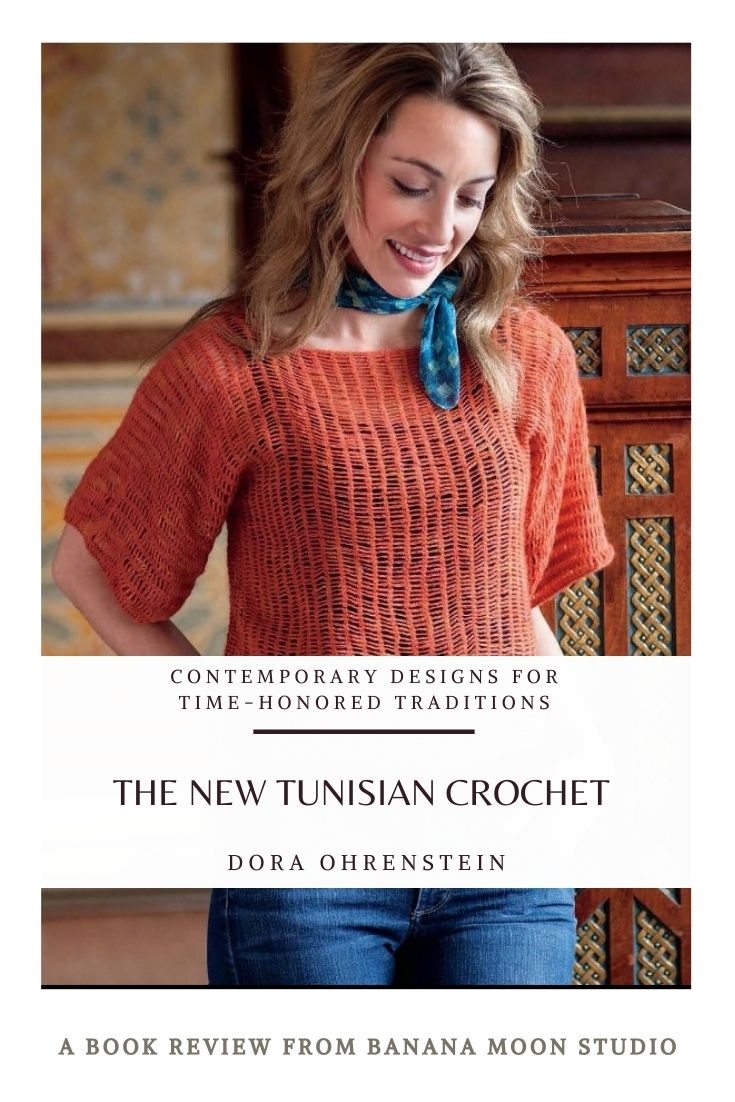 Woman wearing an orange Tunisian crochet top over a black camisole, a blue neck scarf, and jeans. Pattern in the book The New Tunisian Crochet by Dora Ohrenstein. Review from Banana Moon Studio.