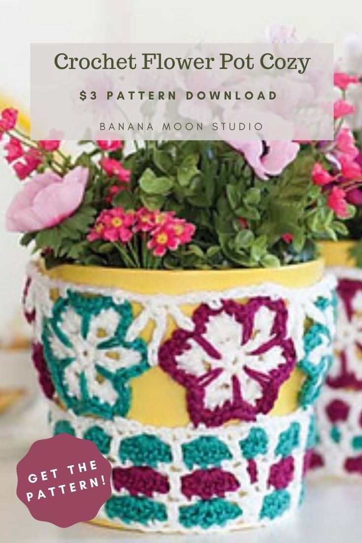 Crochet flower pot cozy with flower motifs and a mosaic stitch. Yellow flower pot with pink flowers. $3 pattern download from Banana Moon Studio.