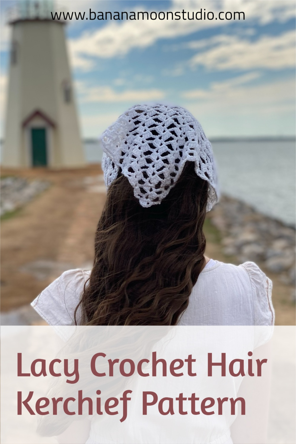 Lacy crochet hair kerchief pattern free from Banana Moon Studio. Girl in white top with long dark hair and a white lace hair kerchief. Light house and lake in the background.