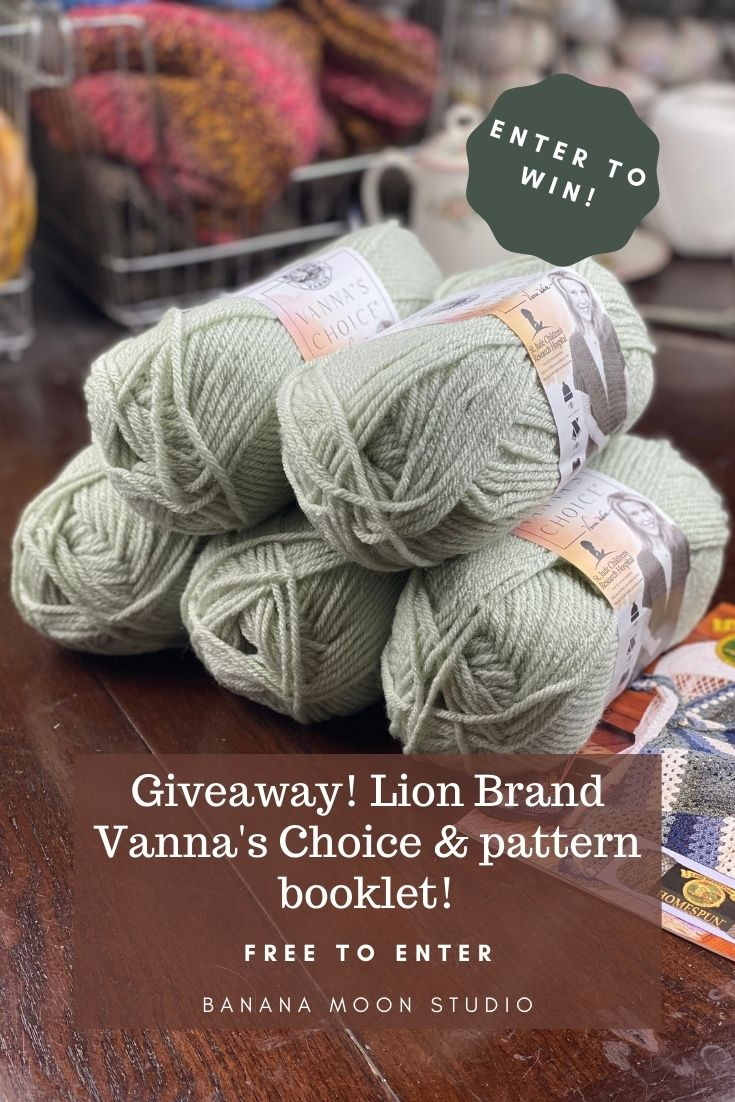 5 skeins of pale green yarn and a pattern booklet on a table with various items in the background. Text reads: Enter to win! Giveaway! Lion Brand Vanna's Choice & pattern booklet! Free to Enter. Banana Moon Studio.