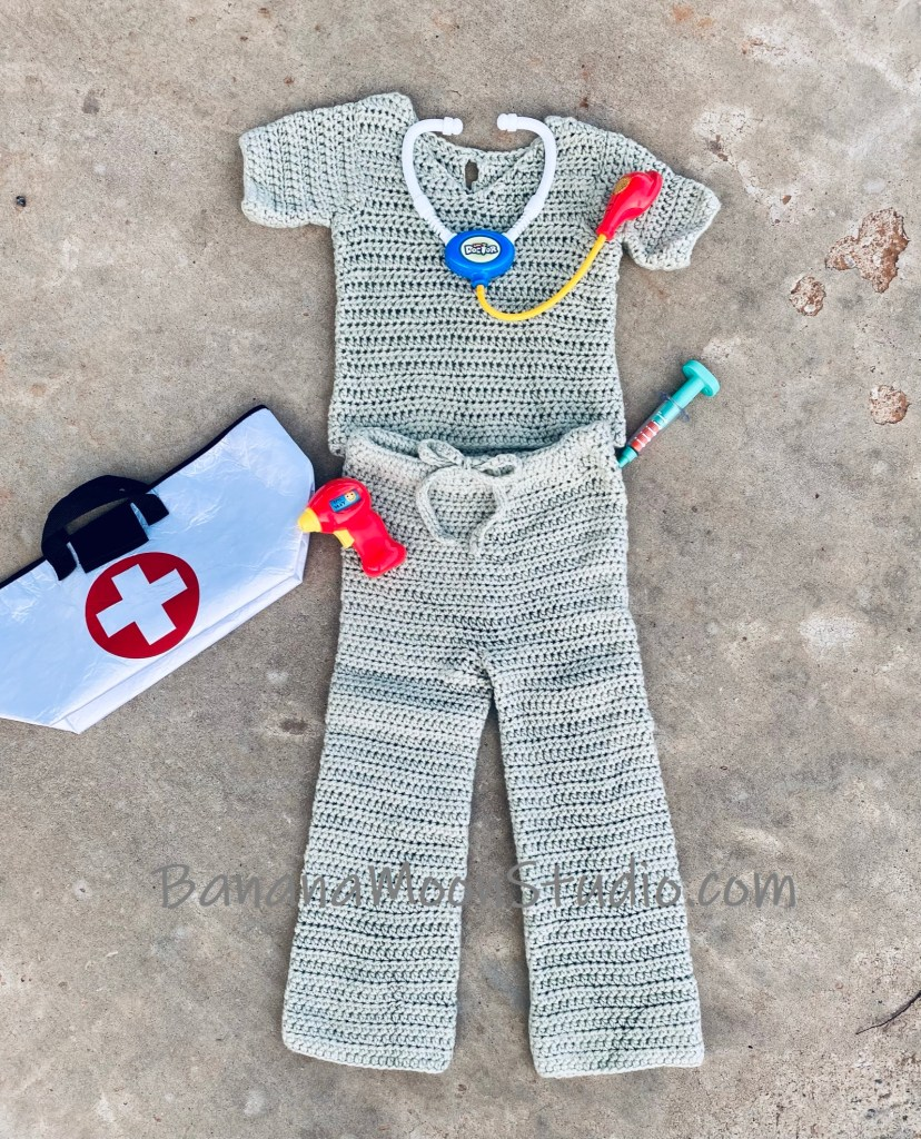 Crochet top and pants that look like nurse's or doctor's scrubs for children. Various children's doctor toys and bag. Text reads: BananaMoonStudio.com