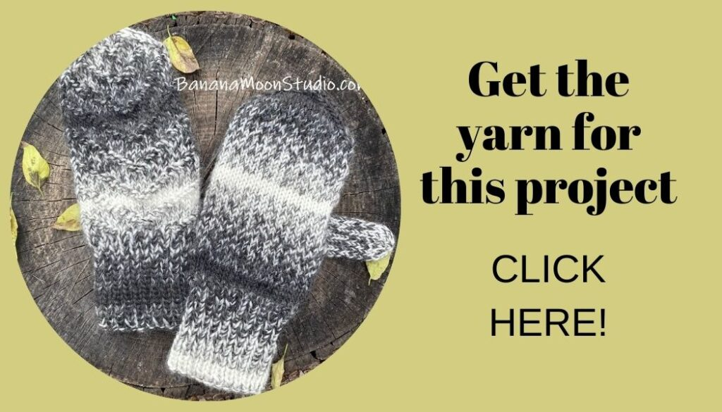 Handknit mittens on a background of wood and yellow fall leaves. Text reads: Get the yarn for this project. Click here!