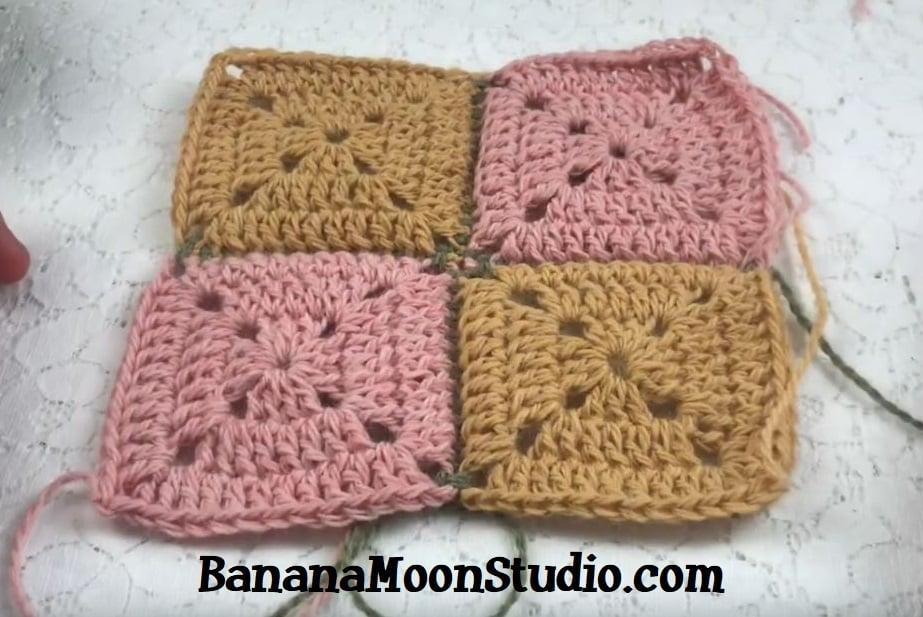 Two pink crochet granny squares and two yellow crochet granny squares seamed together. Text reads: BananaMoonStudio.com.