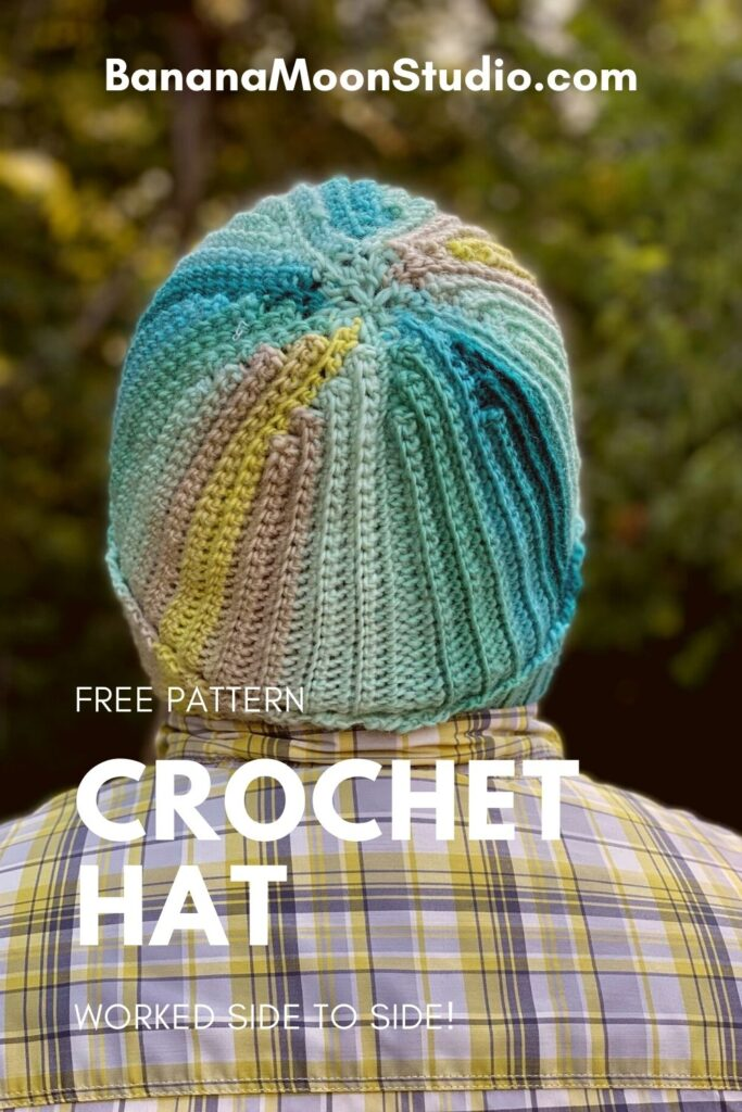 Crochet this side to side ribbed hat with the free pattern from Banana Moon Studio! Man wearing a crochet hat with his back to the camera. Text reads BananaMoonStudio.com. Free pattern. Crochet hat. Worked side to side.