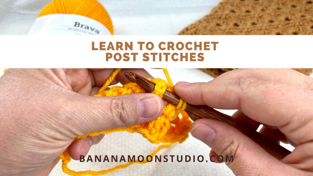 Hands holding crochet hook and bright orange swatch crocheting a front post stitch. Text reads: Learn to crochet post stitches. BananaMoonStudio.com.